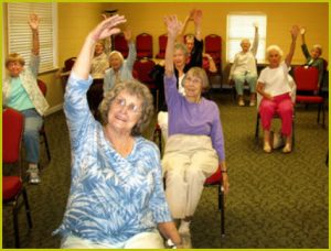 alt text = older adults exercise sitting in chairs