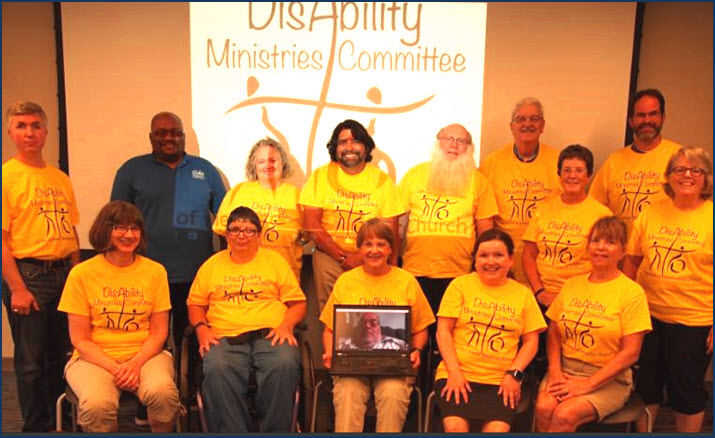 alt text=DMC committee members in yellow shirts and smiling