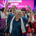 Alt Text = DisAbility chairperson raises arms in praise at United Methodist Women 2018 Assembly