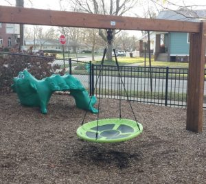 alt txt= green flying saucer swing and dinosaur